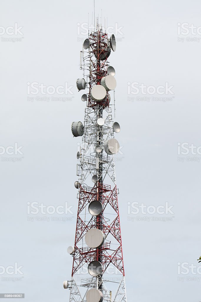 Telecommunications tower sky gray background stock photo