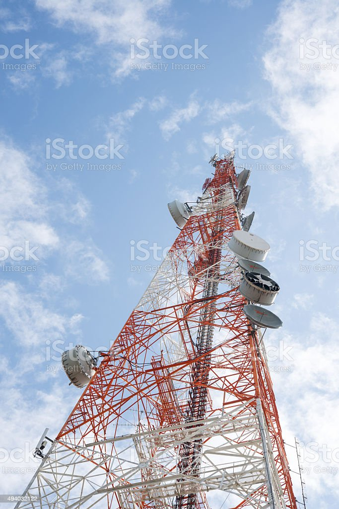 Telecommunications tower with clear blue sky stock photo