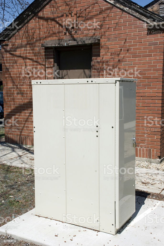V-RAD Telecommunications Utility Box in a Yard stock photo