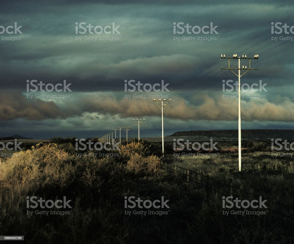 telegraph poles at sunset, graaf reinet, karoo, south africa stock photo