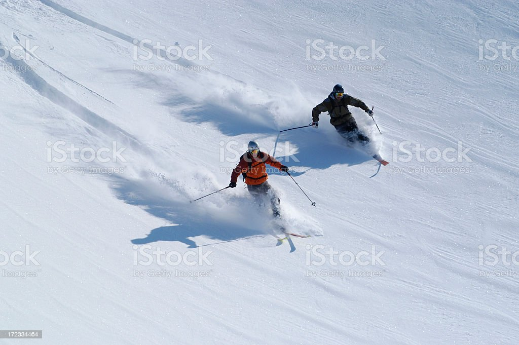 Telemarkers heading down the slopes in Neve Fresca royalty-free stock photo