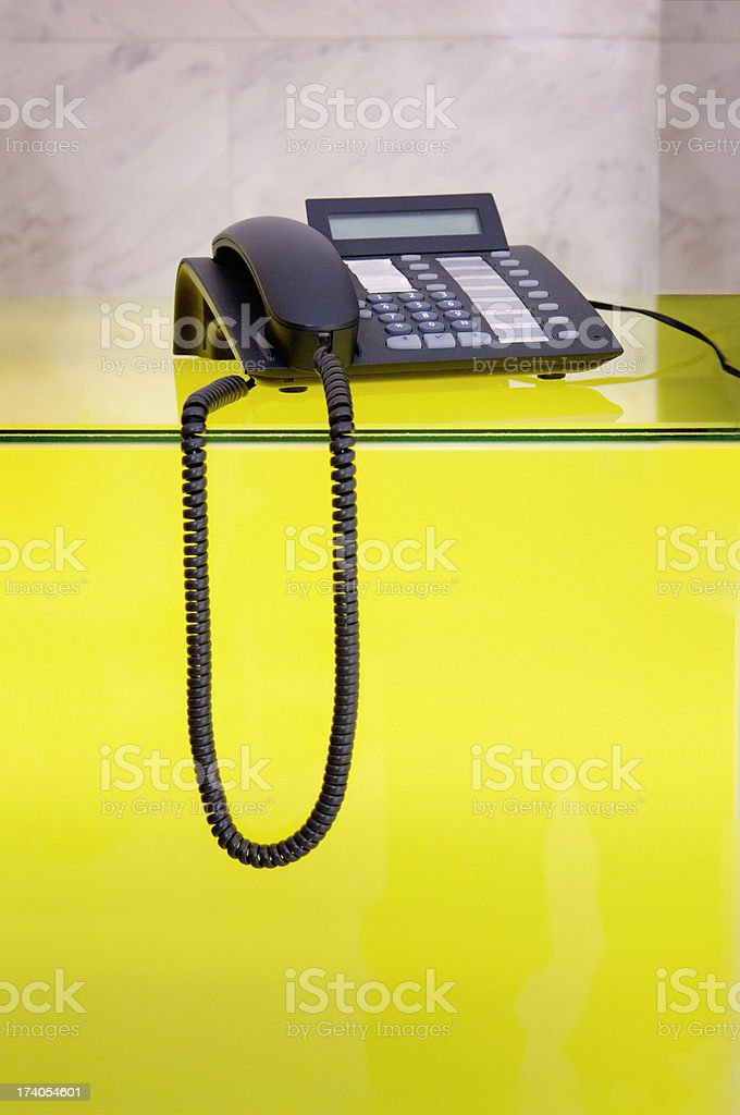 Telephone above yellow table royalty-free stock photo