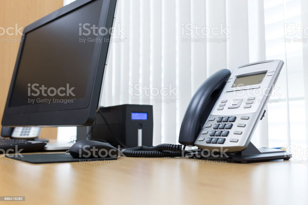 telephone and computer on table work of room service office stock photo