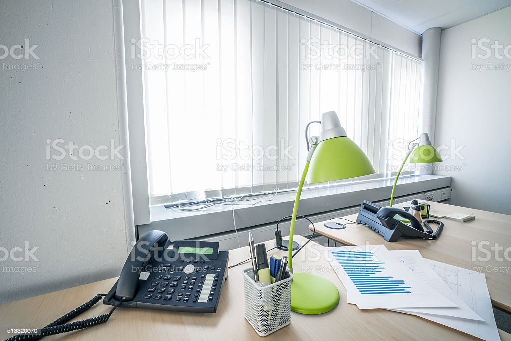 Telephone and green lamps in a office stock photo