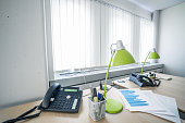 Telephone and green lamps in a office