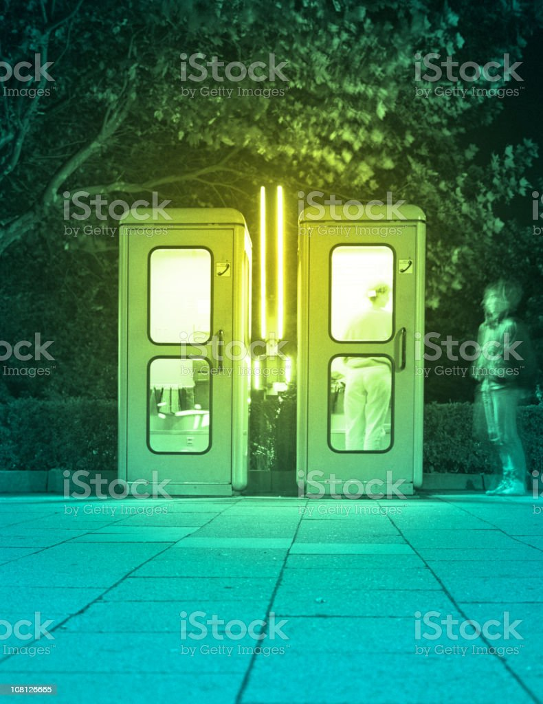 Telephone Booth with Two People Inside royalty-free stock photo