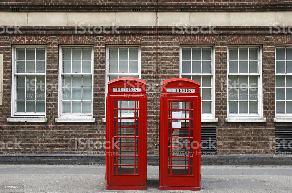 Telephone booths on London street royalty-free stock photo