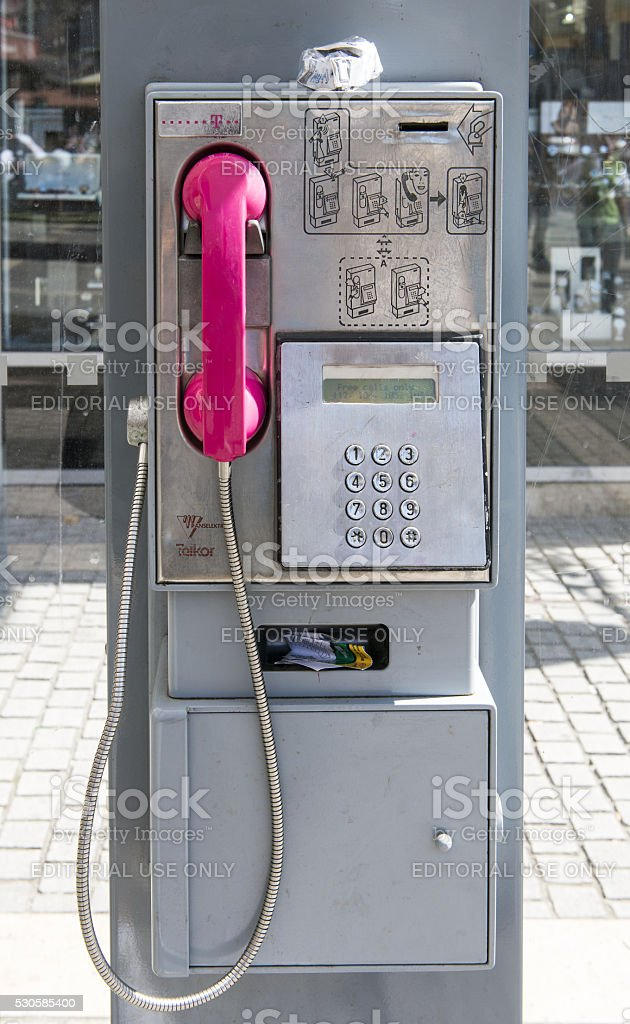 Telephone box with pink handset stock photo