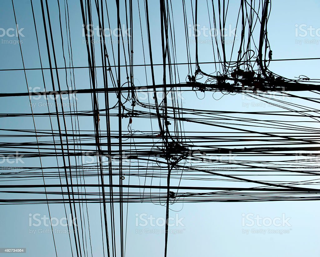 Telephone, electricity pole and wires stock photo