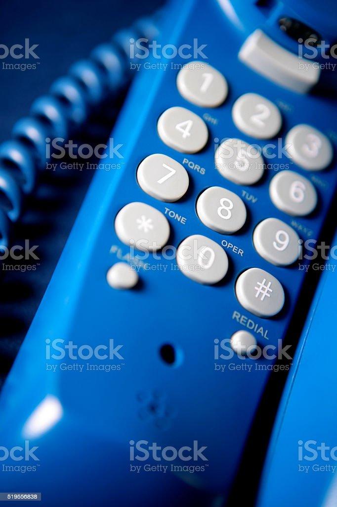Telephone keypad close-up (blue) stock photo