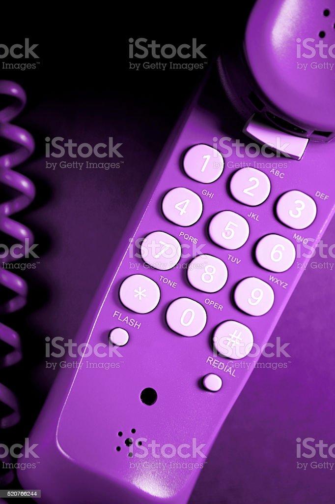 Telephone keypad close-up (purple) stock photo