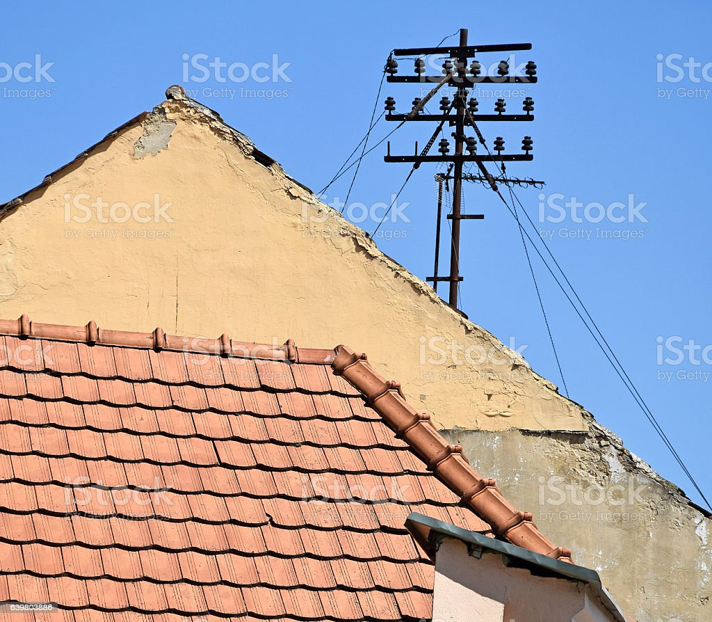 Telephone lines and roofs stock photo