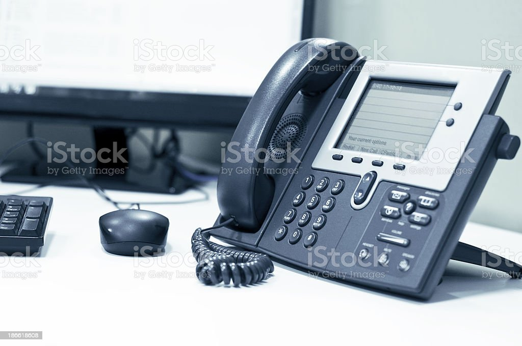 Telephone on an office desk royalty-free stock photo