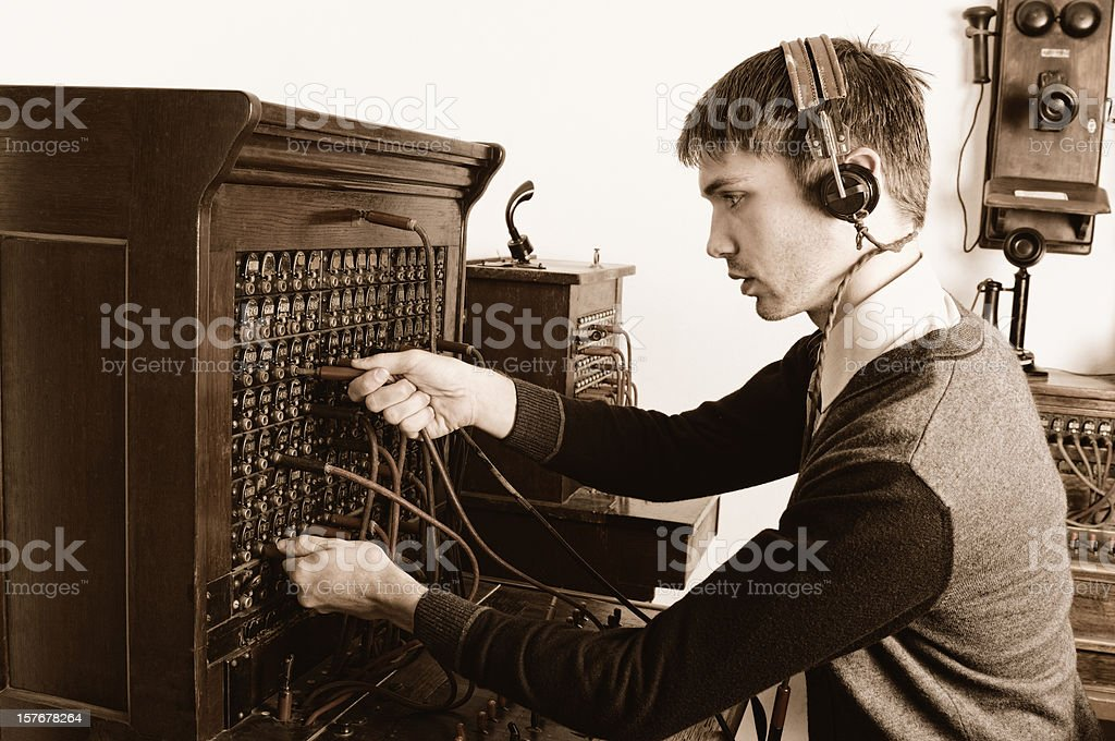 Telephone operator using antique switchboard stock photo