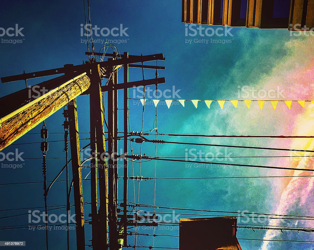 Telephone pole against an ominous sky royalty-free stock photo