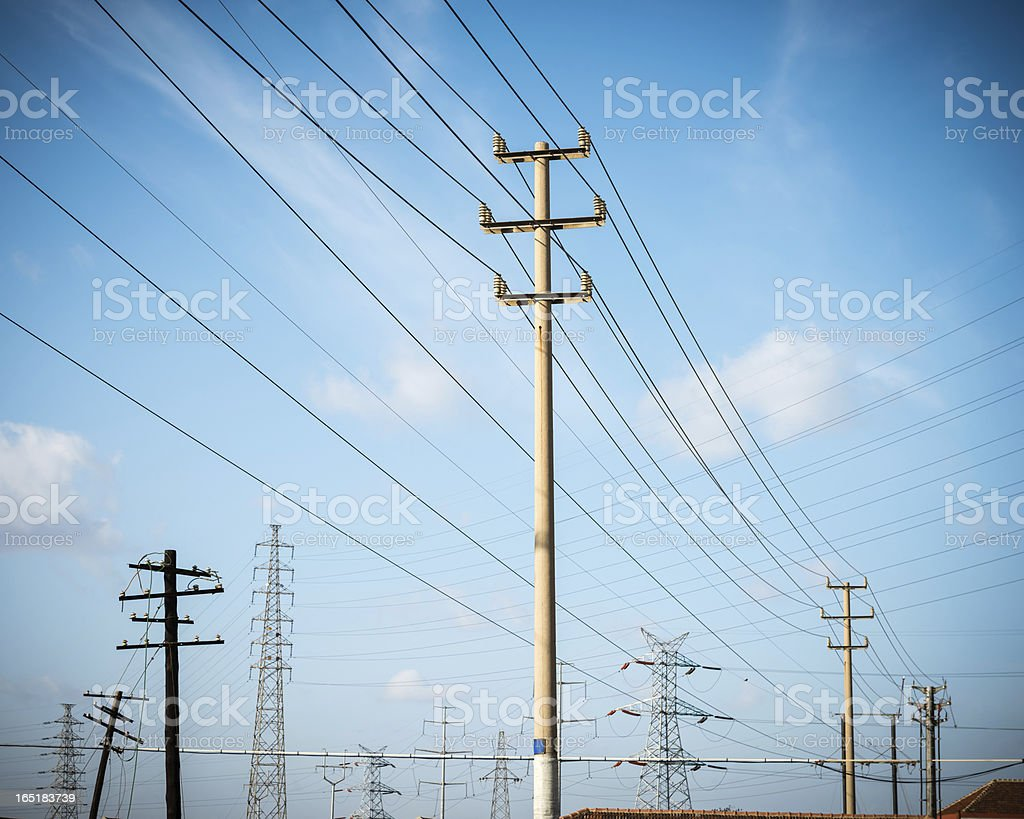 Telephone Pole and Electricity Pylon stock photo
