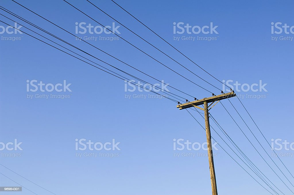 Telephone Pole and telephone lines in the blue sky stock photo