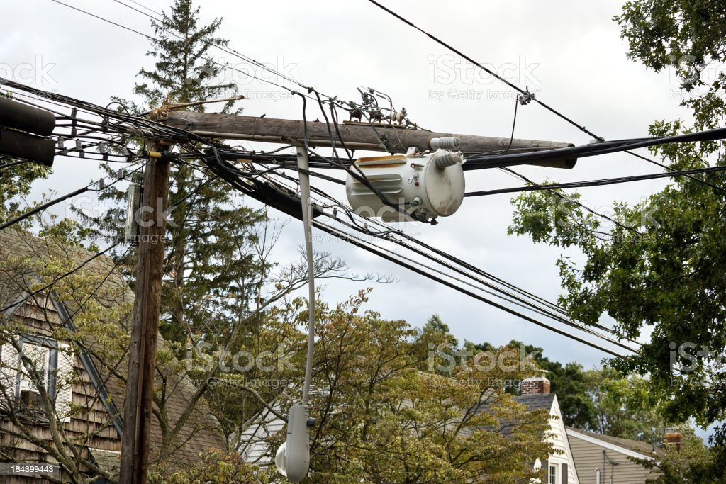Telephone pole snapped in half from storm stock photo