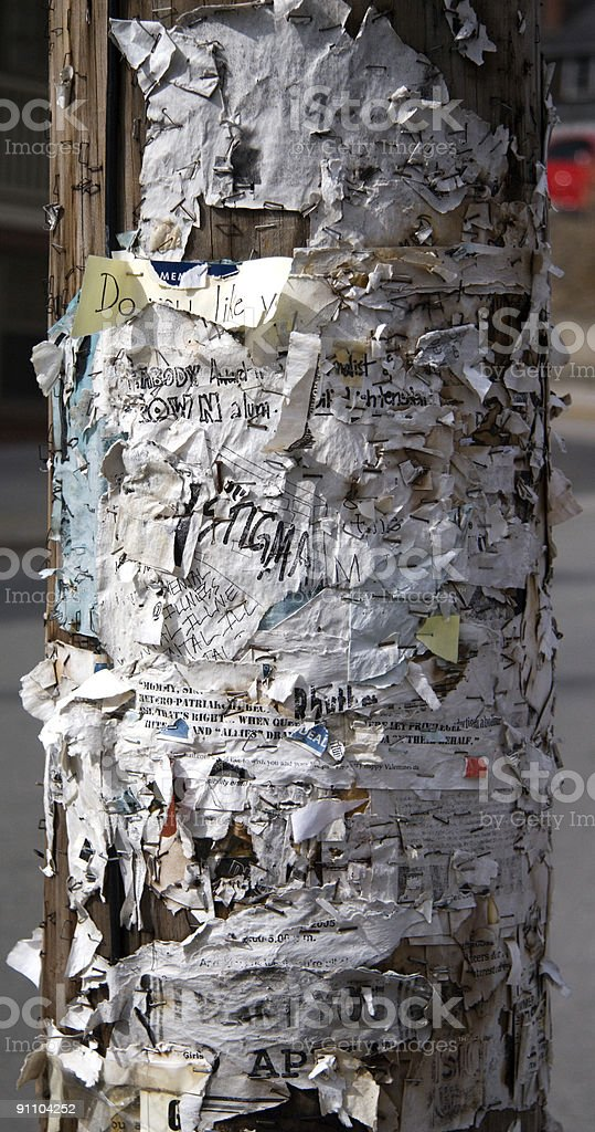 Telephone pole with paper signs stock photo