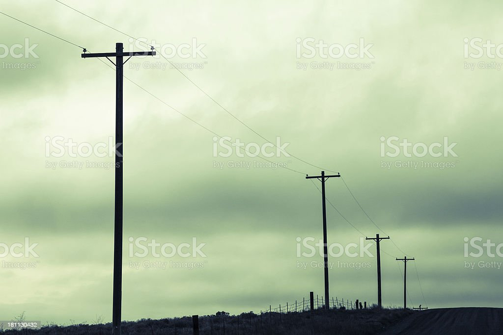 Telephone Poles Green Clouds Sky royalty-free stock photo
