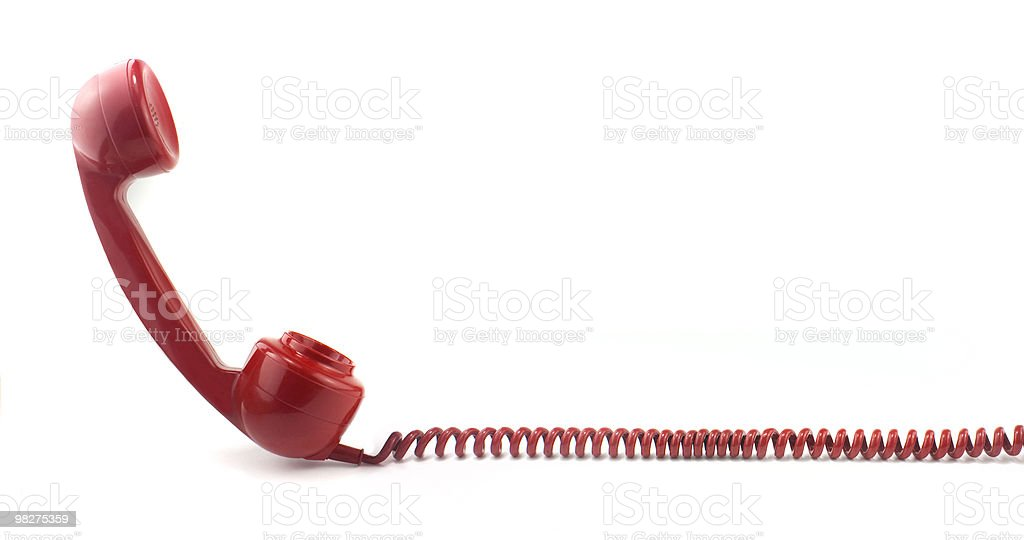 Telephone receiver and curly cord stock photo