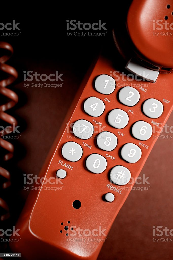 Telephone receiver close-up (red) stock photo