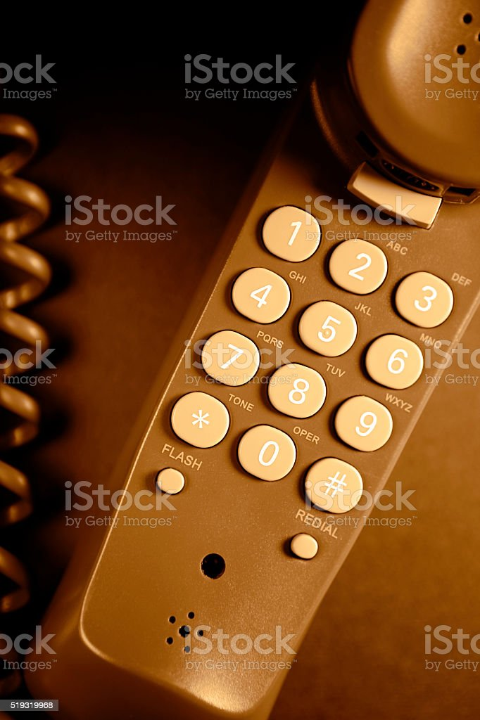 Telephone receiver close-up (brown) stock photo