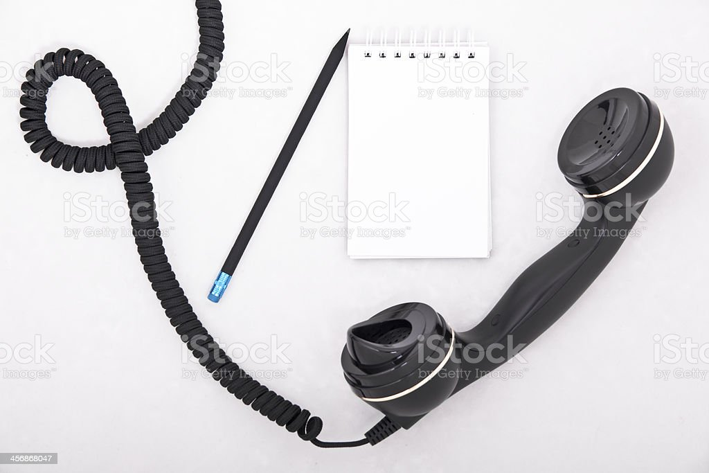 telephone receiver with pencil and notebook royalty-free stock photo