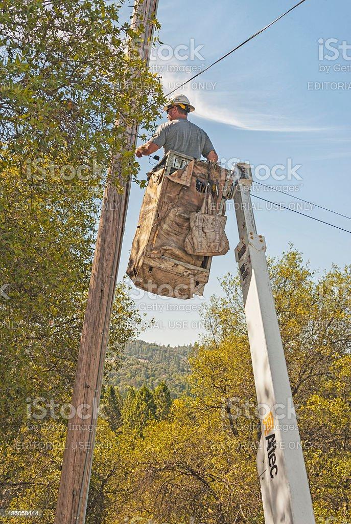 Telephone Repairman on Cherry Picker stock photo