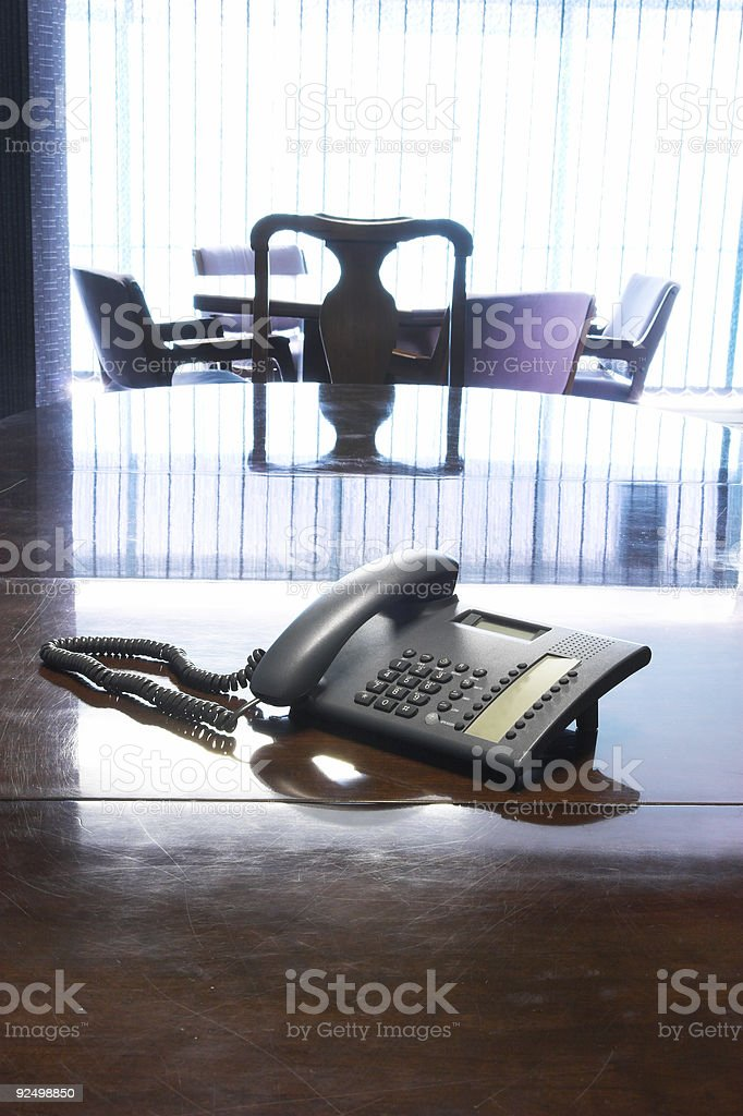 PABX telephone standing on table  in boardroom royalty-free stock photo