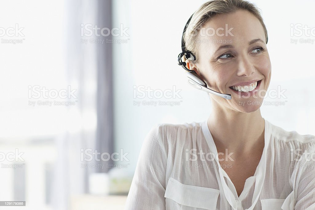 Telephonist working in a call centre stock photo