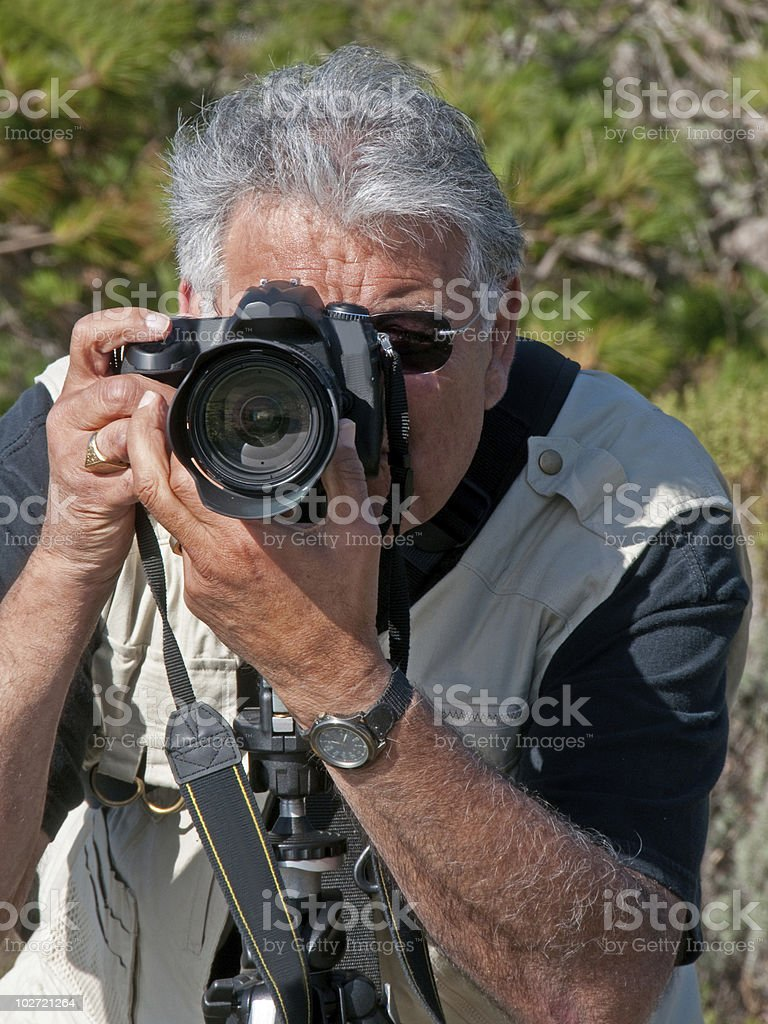 Telephoto Shot of Photographer in Action stock photo