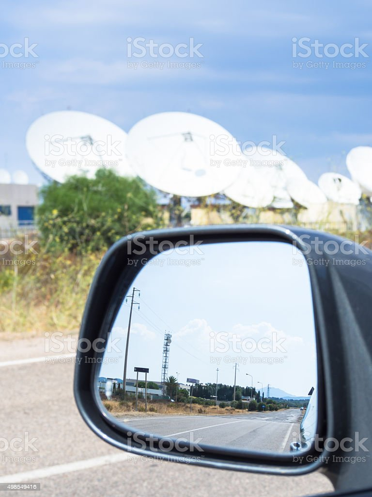 teleport satellite communications with rearview mirror stock photo