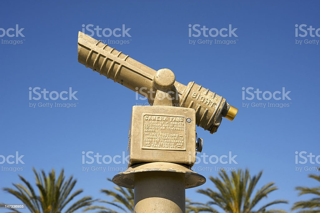 Telescope and palm trees royalty-free stock photo