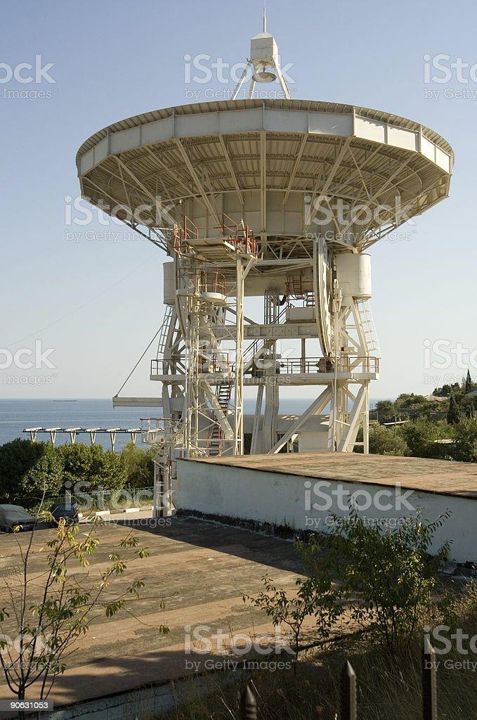 telescope antenna on sea side stock photo
