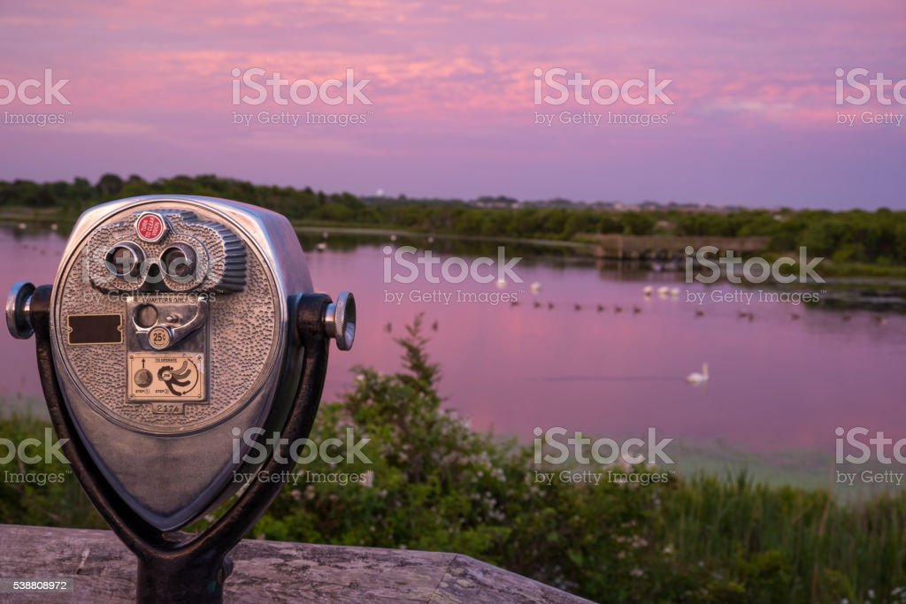 telescope by the lake stock photo
