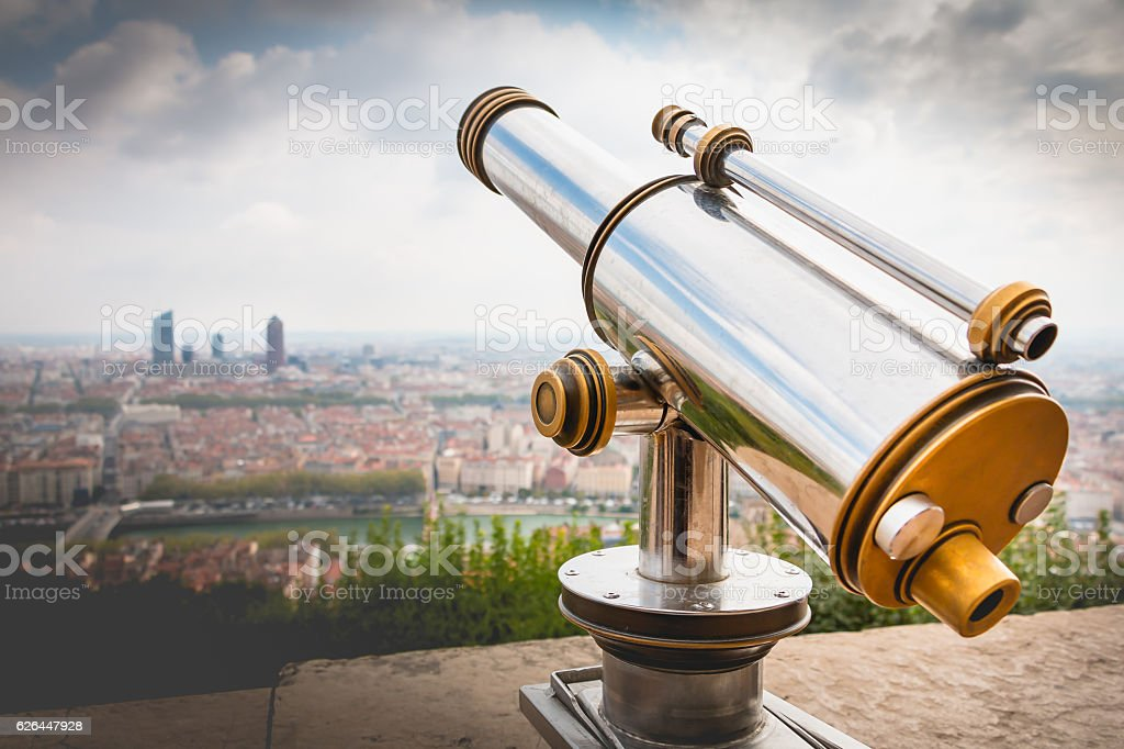 Telescope directed towards the city of Lyon, France stock photo