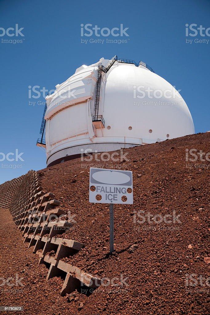 Telescope on Mauna Kea with Falling Ice Sign royalty-free stock photo