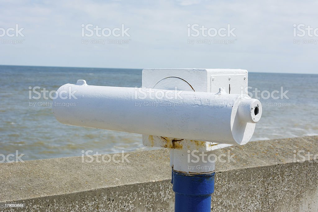 Telescope on seaside promenade. royalty-free stock photo