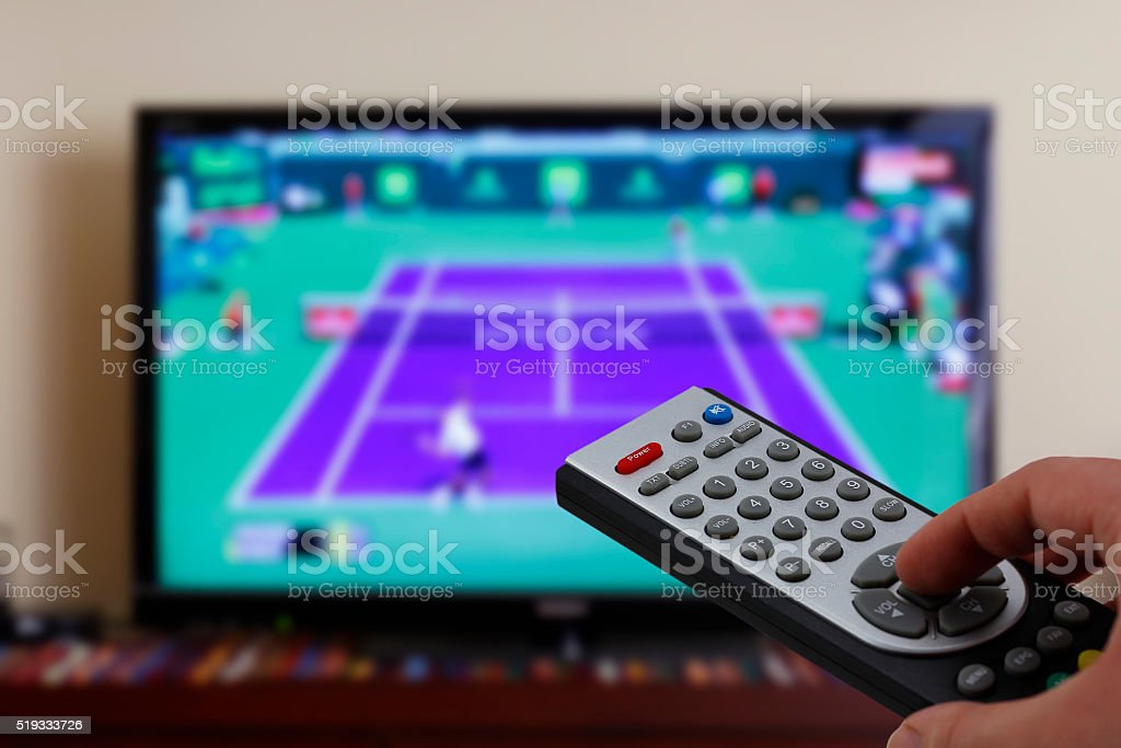 Televesion remote control in the hand, zapping stock photo
