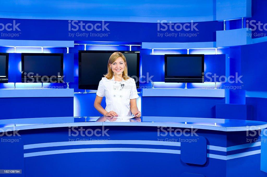 television anchorwoman at TV studio stock photo