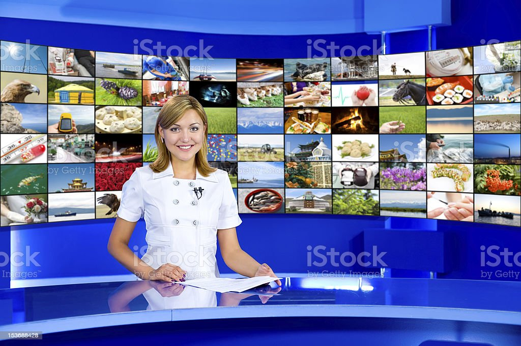 television anchorwoman at TV studio stock photo