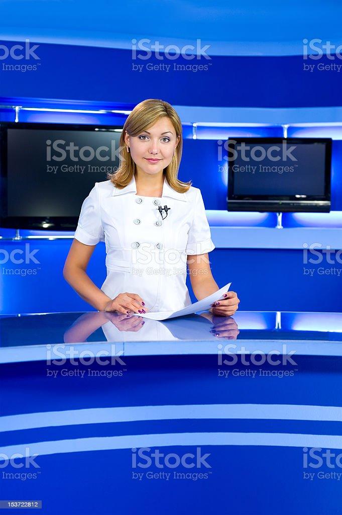 television anchorwoman at TV studio royalty-free stock photo