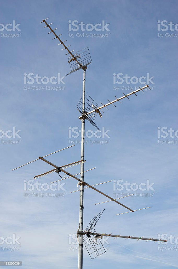 Television Antenna Against A Blue Sky royalty-free stock photo