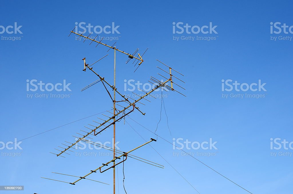 Television antenna and blue sky royalty-free stock photo