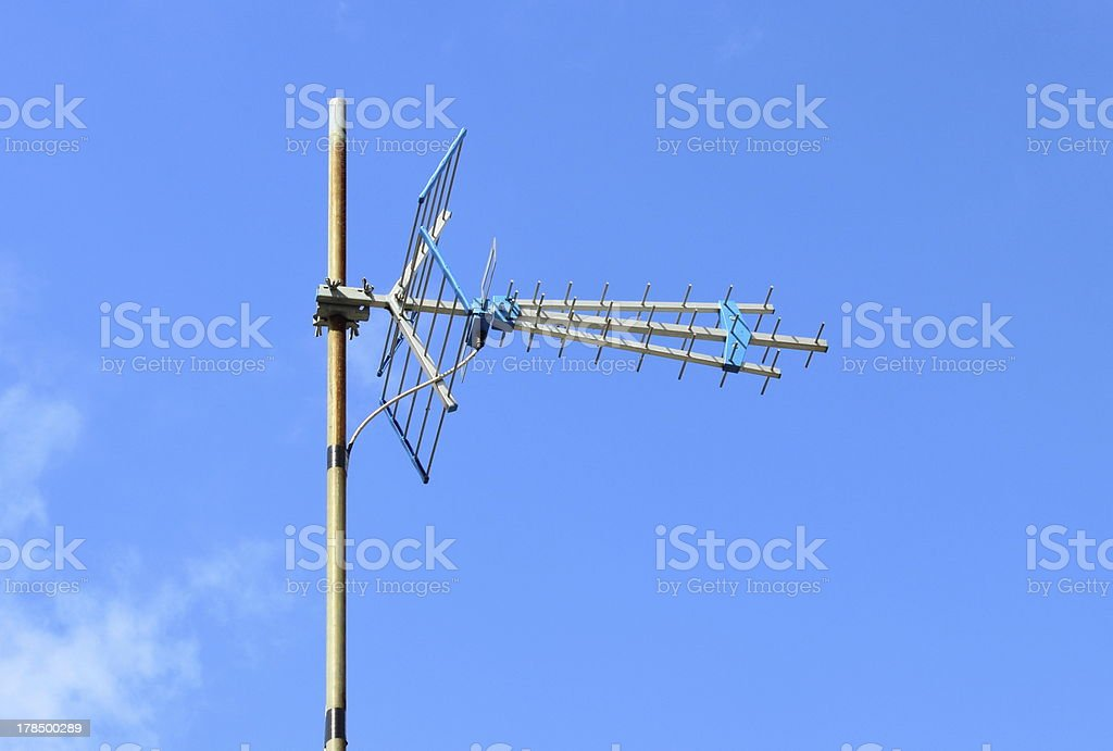 Television antenna home receiver on a blue sky royalty-free stock photo