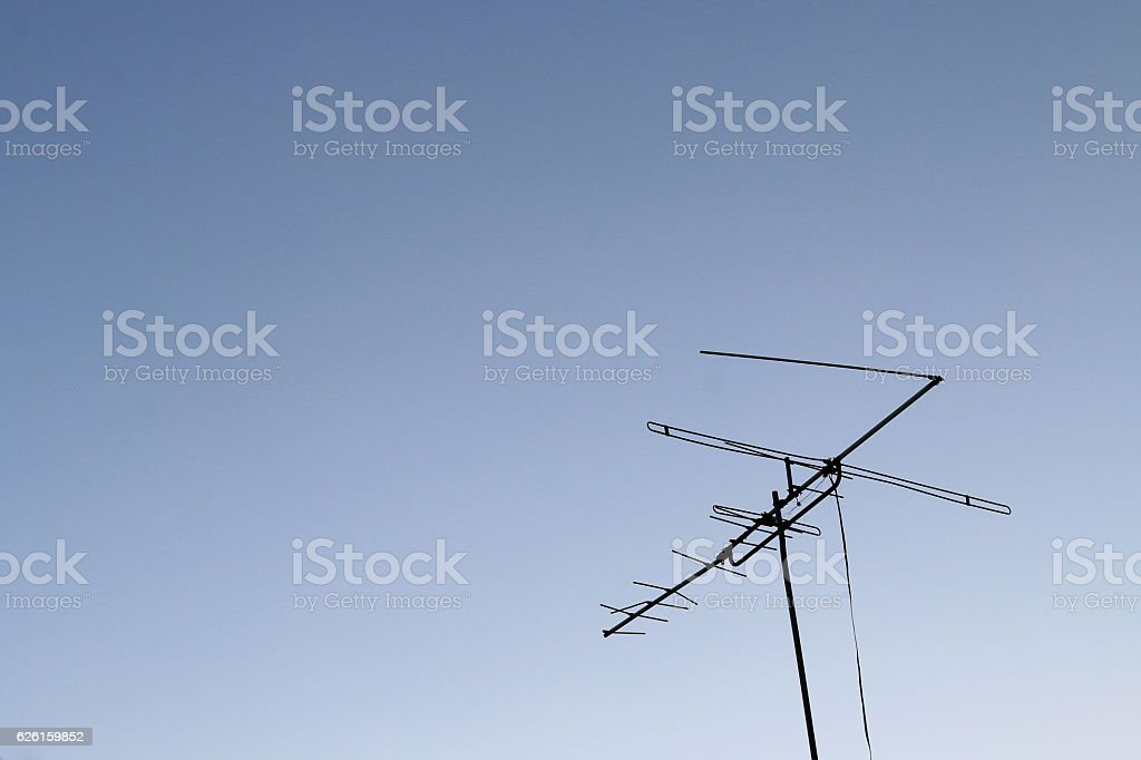 television antenna set against a blue sky. stock photo