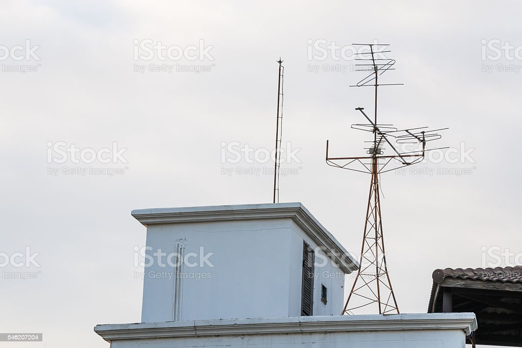 television antenna telecommunication with clouds,blue sky. stock photo