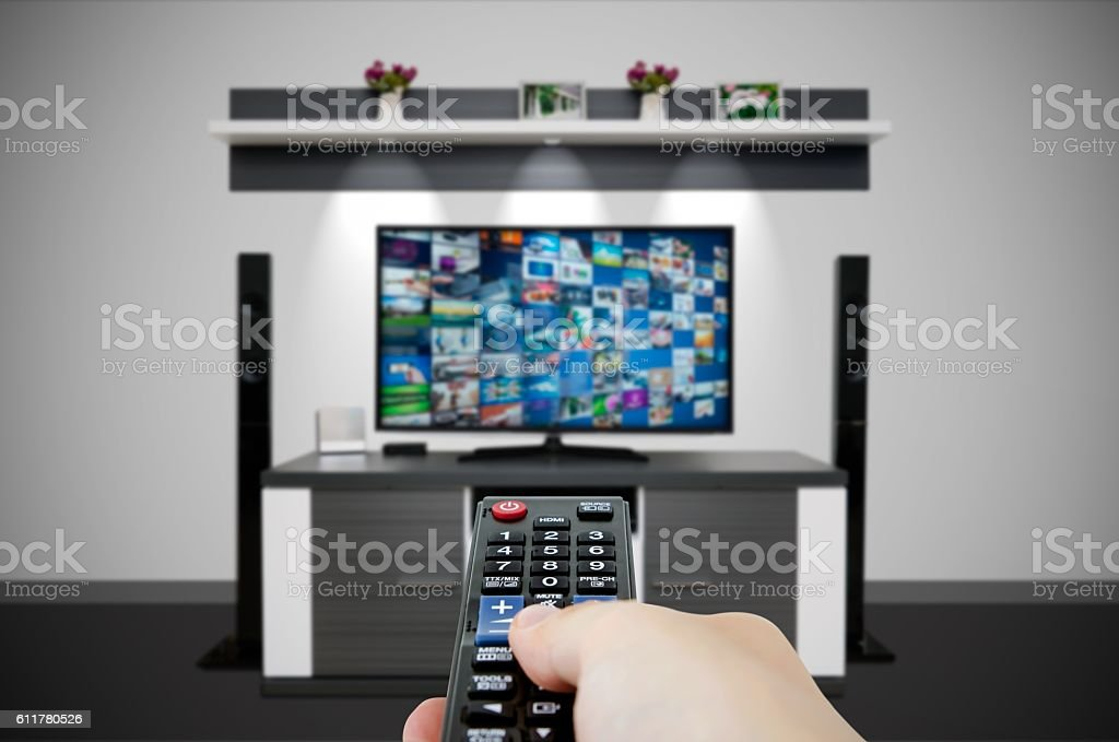 Television broadcast multimedia composition in room and remote control stock photo