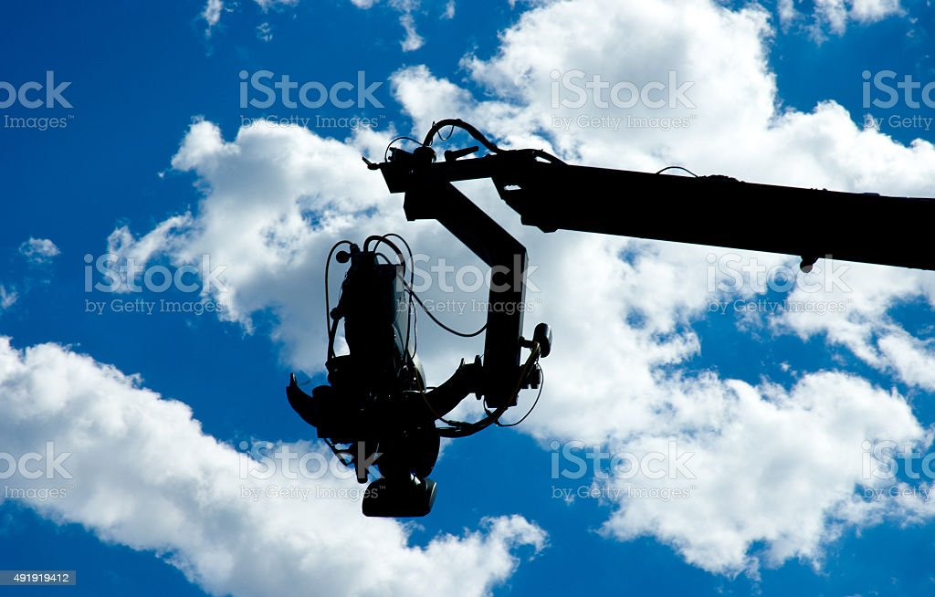 Television camera on dolly silhouette stock photo